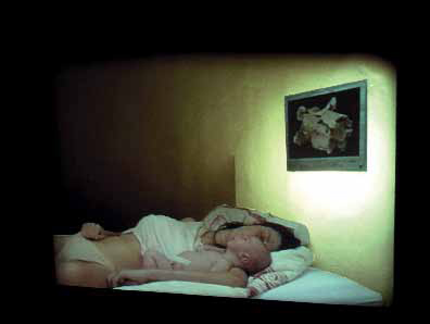 'Mother & Child', 2004, metallic gold paint, video projection