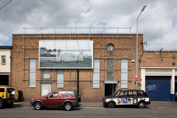 Billboard from 'Does your contemplation of the situation fuck with the flow of circulation', 2009, exterior view of Eastside Projects, Birmingham, also featuring Scott Myles'i!(Eastside Projects)', 2009, marbling on aluminium in existing window bays