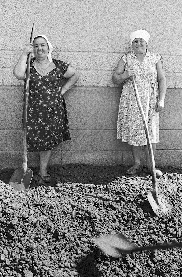 Two women who have built over 100km of roads together. One says You have people called housewives dont you? Road builders, Caucasus, Women Workers, Russia, 1989, Franki Raffles