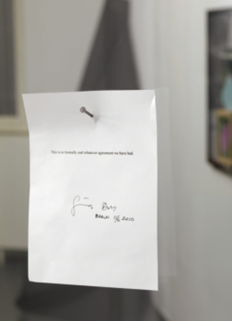 To Whom it May Concern', 2010, inkjet print on paper, nail, glass door. Courtesy Galerie Kamm Berlin. Photo Jens Ziehe