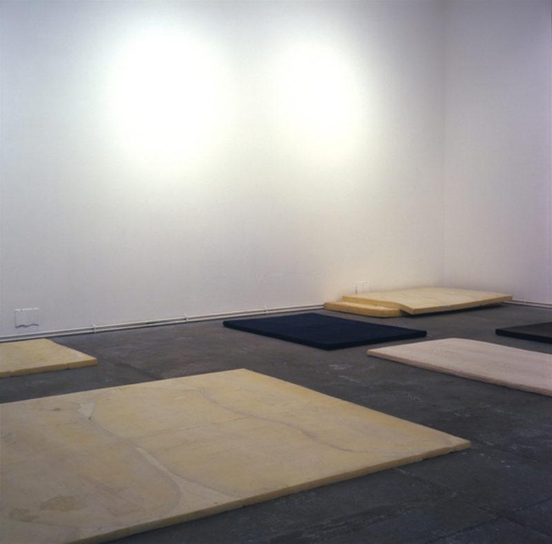 'Living/Sleeping', 2007, cast flexible expanding foam, various fabric, blanket