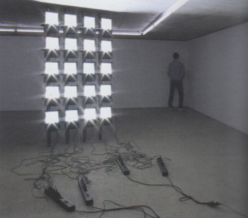 Santiago Sierra, 'Audience Lit by a Petrol Operated Generator', 2008 and 'Veteran Standing in the Corner', 2011, installation view KOW, Berlin
