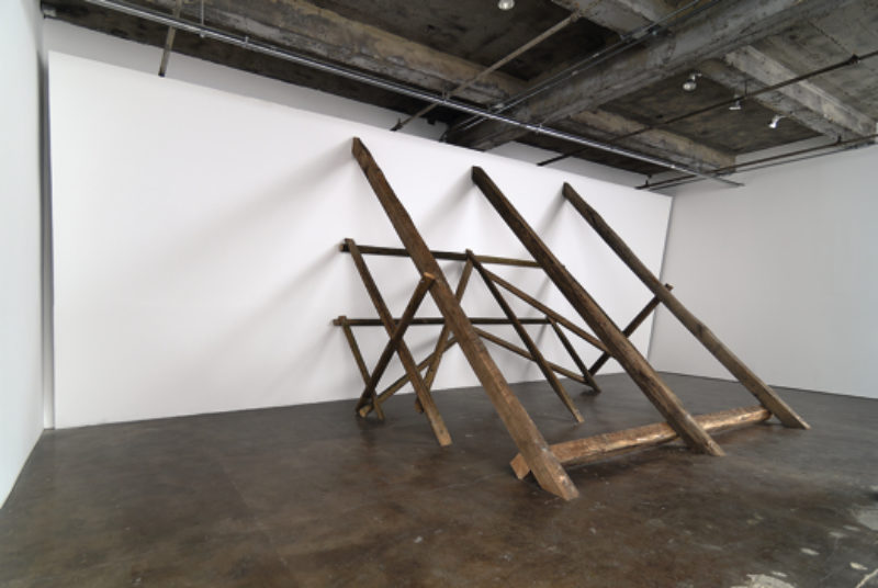 David Lamelas, 'Untitled (Falling Wall)', 1993, sheetrock, cedar and black locust wood, installation view at 'Wood' Maccarone, September 2009. Courtesy Maccarone New York