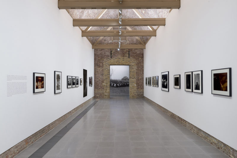 (Foreground) Photographs by Ming Smith, (background) Arthur Jafa, Installation view 'A Series of Utterly Improbable, Yet Extraordinary Renditions', Serpentine Sackler Gallery, London (08 June 2017 10 September 2017). Image Mike Din